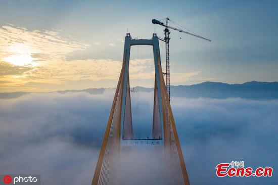 Spectacular high bridge shrouded by fog