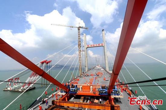 China completes world's longest cross-sea road-rail bridge